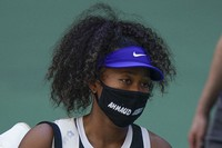 Naomi Osaka, of Japan, walks off the court after winning a match against Marta Kostyuk, of the Ukraine, during the third round of the US Open tennis championships, on Sept. 4, 2020, in New York. (AP Photo/Seth Wenig)