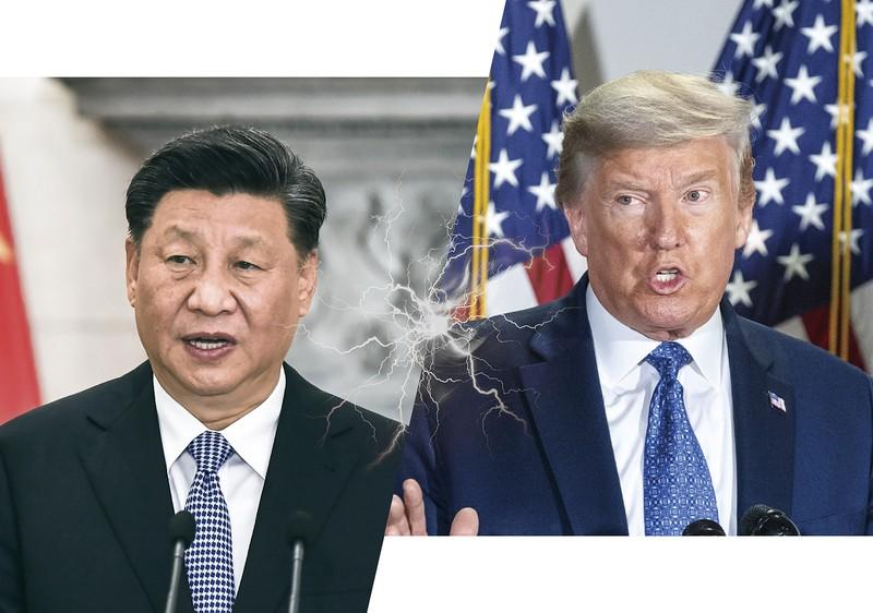 対立は経済から教育・文化交流の分野にまで広がっている(トランプ米大統領〈右〉と習近平中国国家主席)(Bloomberg)