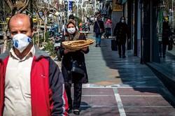 コロナ禍で人通りはまばらだが、普段はにぎやかなテヘラン市内 (Bloomberg)