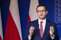 Poland's Prime Minister Mateusz Morawiecki speaks during a news conference following joint meetings of the Lithuanian and Polish governments at the Palace of the Grand Dukes of Lithuania in Vilnius, Lithuania, on Sept. 17, 2020. (AP Photo/Mindaugas Kulbis)