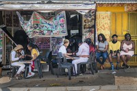 In this Sept. 16, 2020 photo, customers have their nails done near the Baragwanath taxi rank in Soweto, South Africa. (AP Photo/Jerome Delay)