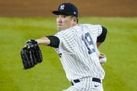 New York Yankees' Masahiro Tanaka, of Japan, winds up during the first inning of the team's baseball game against the Toronto Blue Jays on Sept. 17, 2020, in New York. (AP Photo/Frank Franklin II)