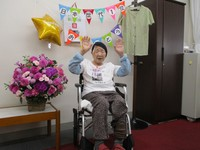 In this photo provided by family, Kane Tanaka is seen wearing a shirt that was given to her by relatives to celebrate her recognition as the oldest person on record in Japan, at a nursing home in the southwestern Japan city of Fukuoka's Higashi Ward, on Sept. 18, 2020.
