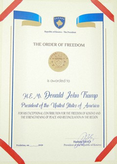 A photo of the Order of Freedom awarded to the U.S President Donald Trump, undersigned by Kosovo's President Hashim Thaci in capital Pristina, Kosovo on Sept. 18, 2020. (AP Photo/Visar Kryeziu)