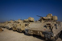 In this Nov. 11, 2019, file photo, Bradley fighting vehicles are parked at a U.S. military base at an undisclosed location in Northeastern Syria, on Nov. 11, 2019. (AP Photo/Darko Bandic)