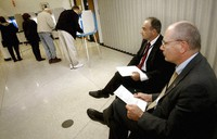 In this Nov. 2, 2004, file photo, parliamentarians Goran Lennmarker, right, of Sweden and Stavros Evagorow, of Cyprus, observe the American voting process as voters cast their ballots at Robbinsdale City Hall in Robbinsdale, Minn. (AP Photo/Jim Mone)
