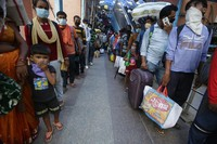 Indian passengers queue up to test for COVID-19 at a facility erected at a railway station to screen people coming from outside the city, in Ahmedabad, India, on Sept. 18, 2020. (AP Photo/Ajit Solanki)