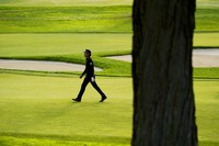 Rafael Cabrera Bello, of Spain, walks up the 12th fairway during the second round of the US Open Golf Championship, on Sept. 18, 2020, in Mamaroneck, N.Y. (AP Photo/Charles Krupa)