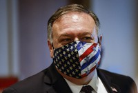 In this Aug. 20, 2020 file photo Secretary of State Mike Pompeo departs a meeting with members of the U.N. Security Council about Iran's alleged non-compliance with a nuclear deal at the United Nation in New York. (Mike Segar/Pool via AP)