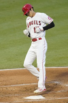 Los Angeles Angels designated hitter Shohei Ohtani crosses home plate after hitting a solo home run during the second inning of a baseball game against the Texas Rangers, Saturday, Sept. 19, 2020, in Anaheim, Calif. (AP Photo/Ashley Landis)