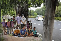 A former diplomat Virendra Gupta and his singer wife Veena Gupta pose for a photograph with underprivileged children whom they teach on a sidewalk in New Delhi, India, on Sept. 3, 2020. (AP Photo/Manish Swarup)