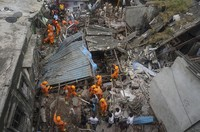 Rescuers look for survivors after a residential building collapsed in Bhiwandi in Thane district, a suburb of Mumbai, India, on Sept.21, 2020. (AP Photo/Praful Gangurde)