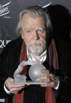 In this Feb. 7, 2011 file photo, actor Michael Lonsdale poses after receiving a Crystal Globe award of best actor during the Crystal Globes awards ceremony, in Paris. (AP Photo/Jacques Brinon)