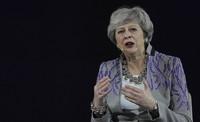 In this Feb. 17, 2020 file photo, former British Prime Minister Theresa May speaks at the Global Women's Forum in Dubai, United Arab Emirates. (AP Photo/Kamran Jebreili)