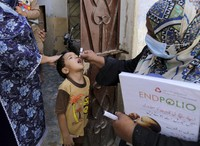 A health worker gives a polio vaccine to a child in Karachi, Pakistan, on Sept. 21, 2020. AP Photo/Fareed Khan)