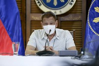 In this photo provided by the Malacanang Presidential Photographers Division, Philippine President Rodrigo Duterte wears a protective mask as he meets members of the Inter-Agency Task Force on the Emerging Infectious Diseases in Davao province, southern Philippines, on Sept. 21, 2020. (Albert Alcain/Malacanang Presidential Photographers Division via AP)