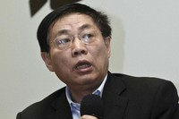 In this Nov. 12, 2010 file photo, Chinese real estate mogul Ren Zhiqiang speaks at a press reception for his book on China's property market, in Shanghai. (Chinatopix via AP)