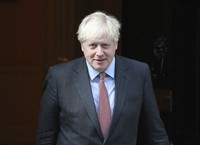 Britain's Prime Minister Boris Johnson leaves 10 Downing Street, London, on Sept. 21, 2020. (Yui Mok/PA via AP)
