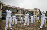 In this May 17, 2020 file photo, nurses who care for coronavirus patients take part in a Zumba dance-fitness class outside of the Kenyatta University Teaching, Referral and Research Hospital in Nairobi, Kenya. (AP Photo/Brian Inganga)