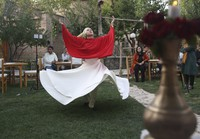 Fahima Mirzaie performs a Sema dance (Sufi Whirling) in Kabul, Afghanistan, on Aug. 20, 2020. (AP Photo/Mariam Zuhaib)