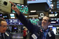 In this March 10, 2020, file photo, traders Steven Kaplan, left, and Gregory Rowe react at the closing on the floor of the New York Stock Exchange. (AP Photo/Richard Drew)