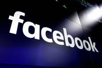 This March 29, 2018, file photo, shows the logo for social media giant Facebook at the Nasdaq MarketSite in New York's Times Square. (AP Photo/Richard Drew)
