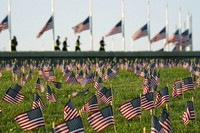 Activists from the COVID Memorial Project mark the deaths of 200,000 lives lost in the U.S. to COVID-19 after placing thousands of small American flags on the grounds of the National Mall in Washington, on Sept. 22, 2020. (AP Photo/J. Scott Applewhite)