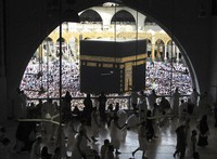 In this May 25, 2019 file photo, Muslim worshippers circumambulate the Kaaba, the cubic building at the Grand Mosque, during the minor pilgrimage, known as Umrah in the Muslim holy city of Mecca, Saudi Arabia. (AP Photo/Amr Nabil)