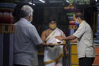 Hindu devotees wearing face masks offer prayers at Shakti Ganesh temple in Hyderabad, India, on Sept. 22, 2020. (AP Photo/Mahesh Kumar A.)