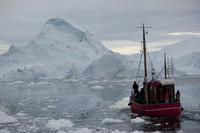 In this July 18, 2011 file photo, a boat steers slowly through floating ice, and around icebergs, all shed from the Greenland ice sheet, outside Ilulissat, Greenland. (AP Photo/Brennan Linsley)