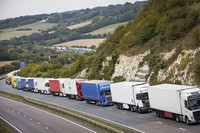 Heavy goods vehicles queue on a main road near Dover, southern U.K., after a police operation in the port city resulted in traffic congestion on nearby roads, on Sept. 16, 2020. (Aaron Chown/PA via AP)