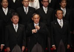 自民党内で高まる解散圧力に、自らのフリーハンドを確保しようと抵抗しているように見える(首相官邸で9月16日)(Bloomberg)