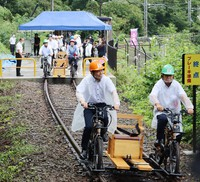 Bicycle-driven trolleys, called Agatsuma Canyon Rail Bike A-Gattan, are seen in the town of Higashiagatsuma, Gunma Prefecture, on Sept. 12, 2020, in this photo provided by the town office.