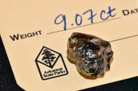 In this Wednesday, Sept. 23, 2020, photo provided by The Arkansas Department of Parks, Heritage and Tourism, a 9.07 carat diamond found by Kevin Kinard at Crater of Diamonds State Park is seen on Sept, 7, 2020, in Murfreesboro, Ark. (Waymon Cox/Arkansas Department of Parks, Heritage and Tourism via AP)
