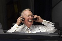 In this Sept. 19, 2016, file photo, Los Angeles Dodgers Hall of Fame announcer Vin Scully puts his headset on prior to a baseball game between the Dodgers and the San Francisco Giants in Los Angeles. (AP Photo/Mark J. Terrill, File)