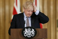 In this Tuesday, March 3, 2020 file photo, Britain's Prime Minister Boris Johnson gestures, during a Downing Street press conference on the government's coronavirus action plan in London. (AP Photo/Frank Augstein, Pool, File)