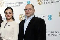 In this Wednesday, Jan. 9, 2019 file photo, BAFTA Chair of the Film Committee Marc Samuelson poses for photographers next to actor Hayley Squires in London. (Photo by Vianney Le Caer/Invision/AP, file)