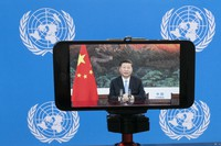 Chinese President Xi Jinping is seen on a video screen remotely addressing the 75th session of the United Nations General Assembly, Tuesday, Sept. 22, 2020, at U.N. headquarters. (AP Photo/Mary Altaffer)