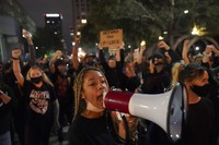 Protesters march, Thursday, Sept. 24, 2020, in Louisville, Ky. (AP Photo/John Minchillo)