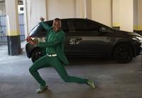 Diogo Jesus, the main dancer for the Mocidade Independente de Padre Miguel samba school, strikes a pose for reporters next to his car, in Rio de Janeiro, Brazil, on Sept. 17, 2020. (AP Photo/Silvia Izquierdo)