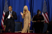 Ivanka Trump, center, waves to the crowd as she takes the stage for a