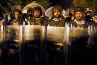 Police officers stand guard near Indian High Commission, while members of the Pakistani Hindu community stage a sit-in protest in Islamabad, Pakistan, on Sept. 24, 2020.(AP Photo/A.M. Chaudary)
