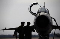 In this April 6, 2016 file photo, ground crew prepare a Mig 21 fighter jet for a flight at the military airport Batajnica, near Belgrade, Serbia. Serbia's defense ministry says that a military jet has crashed near the country's border with Bosnia. (AP Photo/Darko Vojinovic)