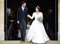 In this Oct. 12, 2018 file photo, Britain's Princess Eugenie and Jack Brooksbank leave St George's Chapel after their wedding at Windsor Castle, in Windsor, England. (Toby Melville, Pool via AP)