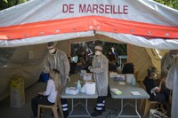People receive COVID-19 tests at a mobile testing center in Marseille, France, on Sept. 24, 2020.  (AP Photo/Daniel Cole)