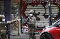 French soldiers patrol after four people have been wounded in a knife attack near the former offices of satirical newspaper Charlie Hebdo, Sept. 25, 2020. (AP Photo/Thibault Camus)