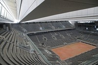 In this May 27, 2020 file photo, a general view of the Philippe-Chatrier tennis court with its new retractable roof is seen during a media tour at Roland Garros stadium in Paris. (AP Photo/Michel Euler)