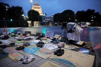 On Sept. 25, 2020, shoes and signs are seen lined up outside the National Diet Building in Tokyo's Chiyoda Ward as part of a
