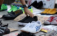 Shoes which were put out in front of the National Diet Building in Japan's capital as part of a