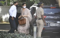Bollywood star Deepika Padukone, center, arrives at the office of the narcotics control board in Mumbai, India, on Sept. 26, 2020. (AP Photo)